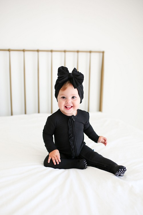 Posh Peanut Black Ribbed Ruffle Footie Zippered One Piece